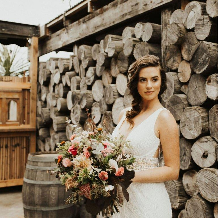 Bride holding flowers - Christchurch wedding venue at The Tannery